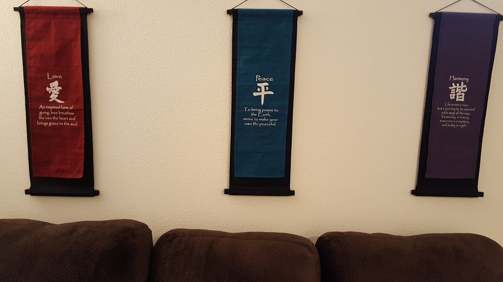 Here is a close-up of the three banners that we hung up behind the couch. One under each window.